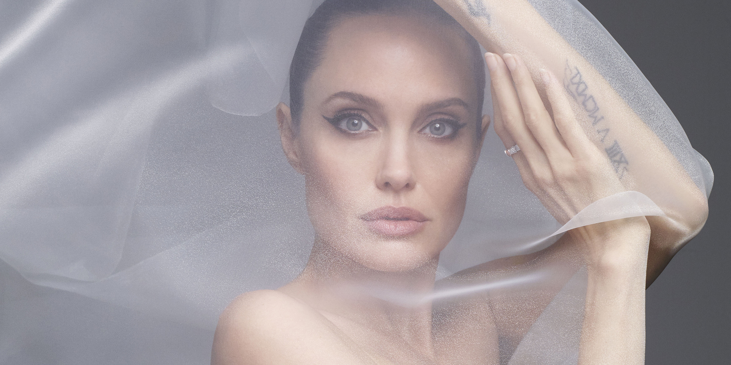 Angelina Jolie poses nude on Harper's Bazaar cover