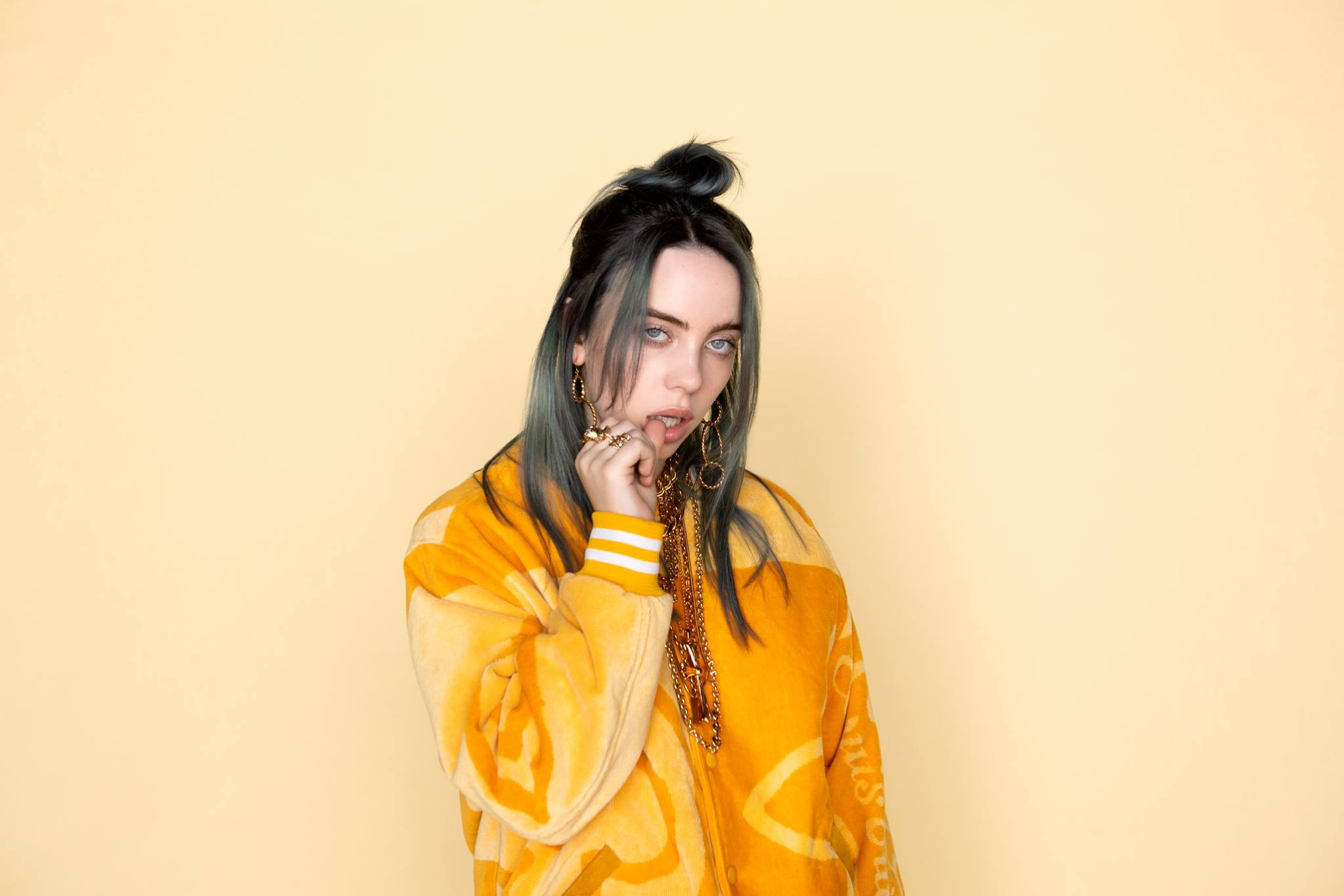 Billie Eilish removes her shirt in a video during a concert to protest against 'body shaming'