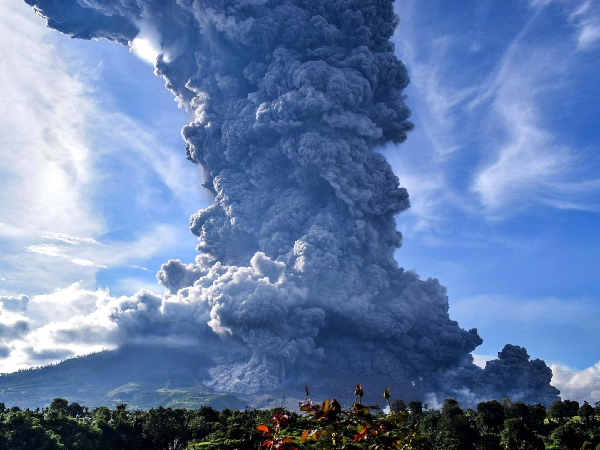 Indonesia volcano: Mount Sinabung spews 3-mile ash cloud in a huge eruption