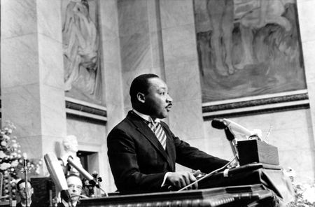 The Rev. Martin Luther King Jr., delivers his Nobel Peace Prize acceptance speech in the auditorium of Oslo University in Norway on Dec. 10, 1964. King, the youngest person to receive the Nobel Peace prize, is recognized for his leadership in the American civil rights movement and for advocating non violence. (AP Photo) ASSOCIATED PRESS