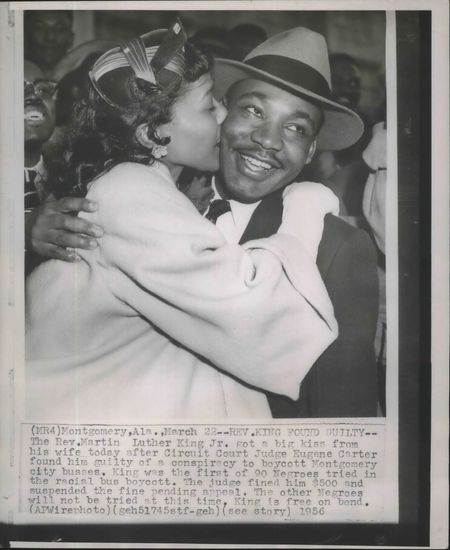 Coretta Scott King gives her husband Martin Luther King Jr. a kiss.