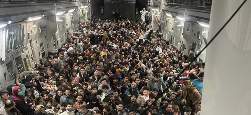 Inside Reach 871, A US C-17 Packed With 640 Afghans Trying to Escape the Taliban